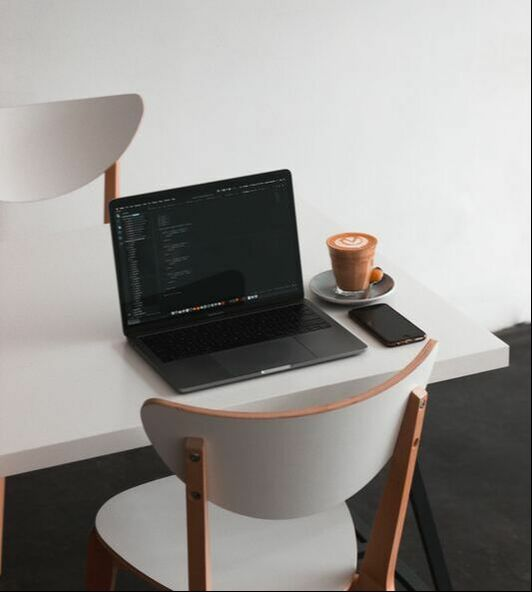 Laptop and coffee set for someone starting their side hustle